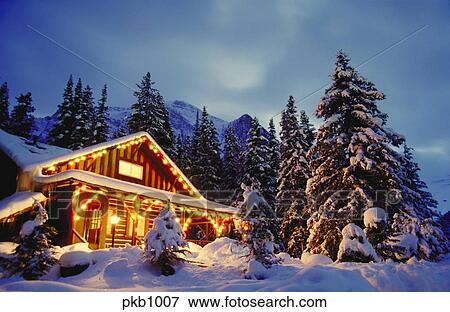 Picture Of Cabin In The Snow With Lights At Night And Snow