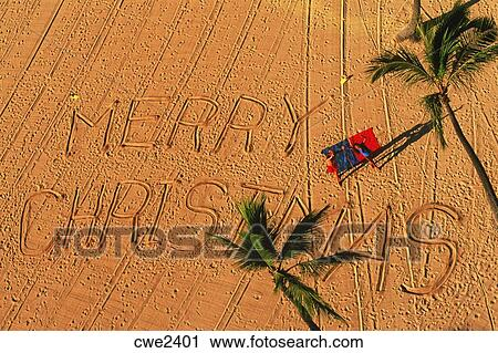 merry christmas written on sandy beach in hawaii - Merry Christmas In Hawaii