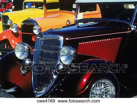 Brightly painted classic old Ford cars from 1940-50s Stock Photo