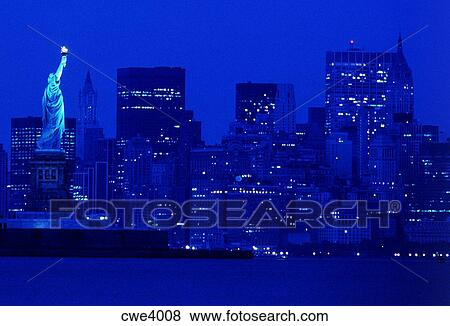 Night Time Skyline Of New York City And Statue Of Liberty Stock Photo Cwe4008 Fotosearch