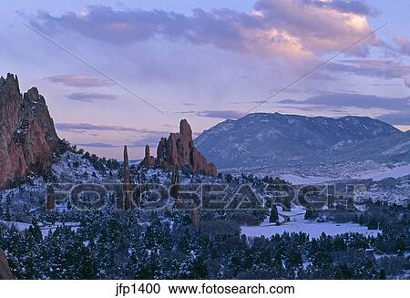 A Winter Sunset Surrounds The Garden Of The Gods Park With