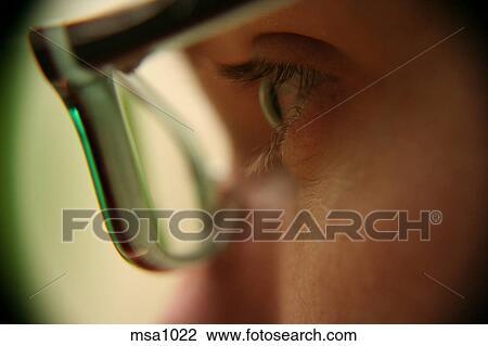 Stock Photo Of Macro Shot Of Mans Eye Behind Plastic Frames In