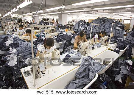 d6ec24fd1c55d7 SHENZHEN, GUANGDONG PROVINCE, CHINA - Workers sewing Mango jeans, in  garment factory in city of Shenzhen, one of mainland China's first Special  Economic ...