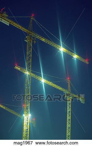 Highrise Tower Cranes Night Lighting Stock Photo