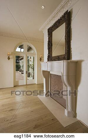 Interior Of Formal DINING ROOM With FIREPLACE Hardwood Floors And Mirror In CALIFORNIA LUXURY HOME