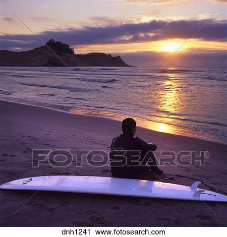 a60b623313 Stock Photography of Surfer at sunset Pacific City