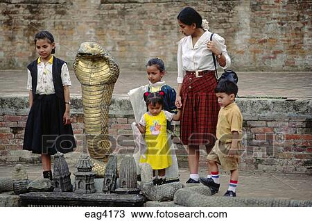 NAGA or snake washing fountain  Legend is that the Newars came from Naga  People - BHAKTAPUR, NEPAL Stock Image