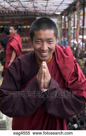 Stock image of tibetan buddhist monk gives the namaste greeting at stock image tibetan buddhist monk gives the namaste greeting at the katok dorjeden monastery m4hsunfo