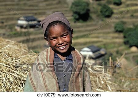 A young GURUNG boy smiles because life is good - ANNAPURNA REGION, NEPAL  Stock Photo