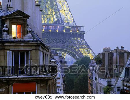 Stock Photography Light In Top Floor Apartment Window With Eiffel Tower Depicting Paris Night Life