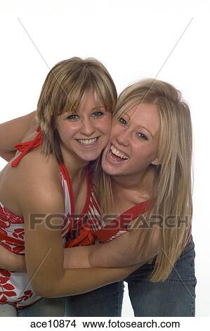 2 Girls Having A Friendly Hug Posing For The Camera
