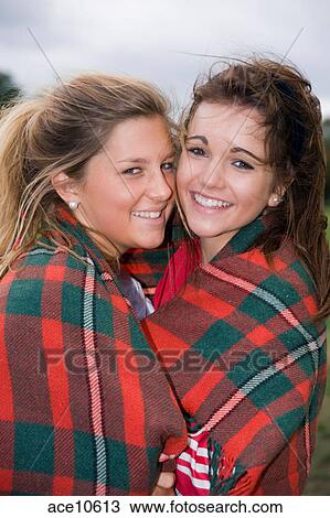 Stock Photo Of 2 Teenage Girls Wrapped Up In A Blanket Posing For