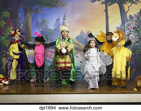 1f996eaaf9 Picture - South Asian Indian boys and girls performing fancy dress  competition on stage in nursery