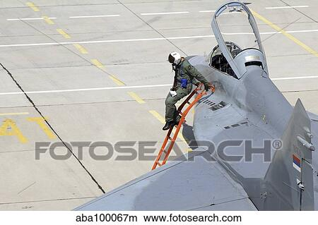 Serbian Air Force pilot climbs down from the cockpit of a MiG-29  Picture