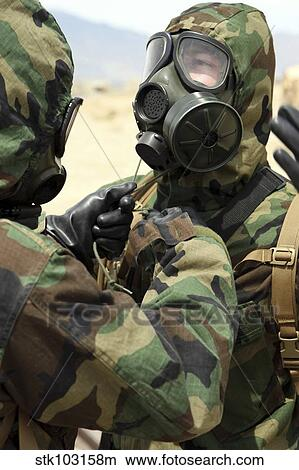 large discount quite nice popular brand U. S. Marine Corps reservists in camouflage and gas masks ...
