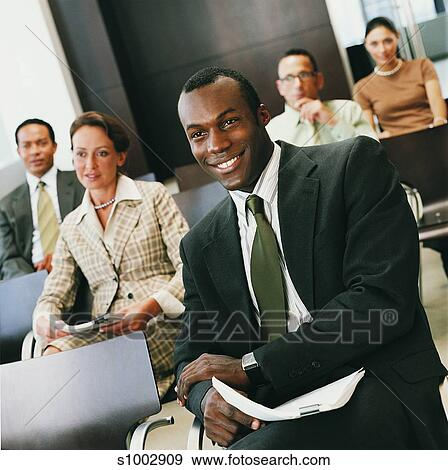 Fantastic Group Of Business People Sitting In A Conference Room Home Interior And Landscaping Ponolsignezvosmurscom