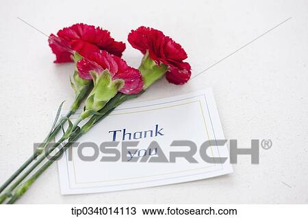 a thank you note with flowers