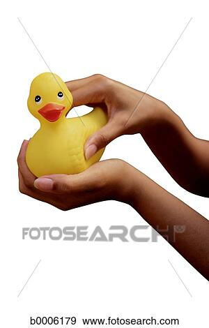 stock photograph of bath hand silhouette rubber duck holding
