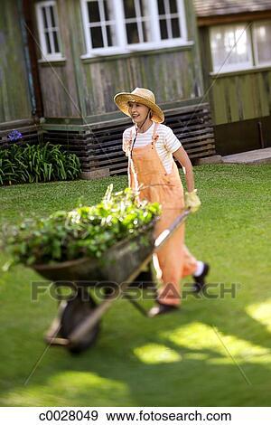 Stock Photograph of gardening, hat, portrait, smiling, mature living ...