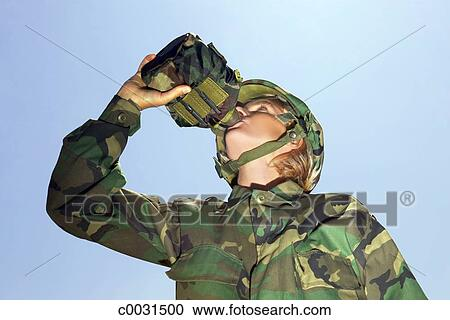 Stock Photography of Low angle of a military soldier in camouflage