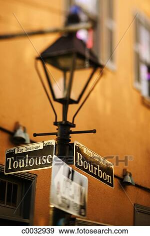 A Lamp Post With Street Signs At The Intersection Of Toulouse And Bourbon Streets In The French Quarter Vieux Carre In New Orleans La Stock Photo