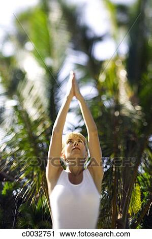 low angle closeup of a woman standing in the yoga