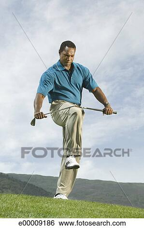 Angry Golfer Bending Golf Club Stock Photograph E00009186 Fotosearch