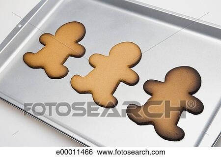 Undecorated Gingerbread Christmas Cookies On Baking Sheet Stock Photograph