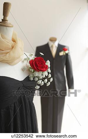 Stock Photo Of Black Dress And Tuxedo With Corsage White Background