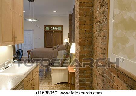 Brick Wall In Small Studio Apartment