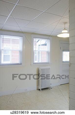 Empty Apartment With Tile Floor And A Heater