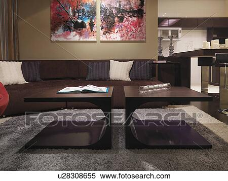 https://fscomps.fotosearch.com/compc/ULY/ULY015/hippe-koffie-tafel-in-woonkamer-stock-afbeelding__u28308655.jpg
