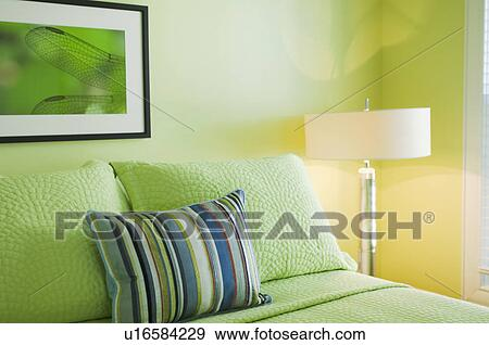 Pillows On Lime Green Bed Stock Photograph U16584229