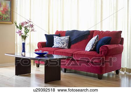 Red Sofa With Blue Accent Throw Pillows Stock Photo U29392518