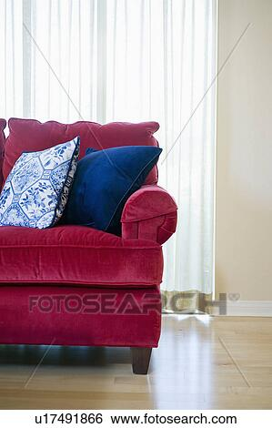 Red Sofa With Blue Accent Throw Pillows Stock Photograph