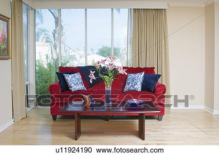 Stock Photography Of Red Sofa With Blue Accent Throw Pillows