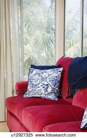 Red Sofa With Blue Accent Throw Pillows Stock Photography