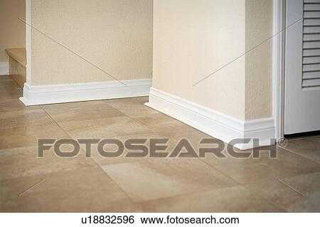 Stock Image   White Baseboard Along Ceramic Tile Floor. Fotosearch   Search  Stock Photography,