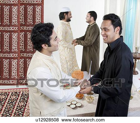 Pictures of muslim men greeting each other u12928508 search stock muslim men greeting each other m4hsunfo