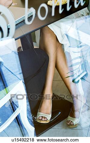 Stock Photo Young Woman S Leg Touching Man Under Table Fotosearch
