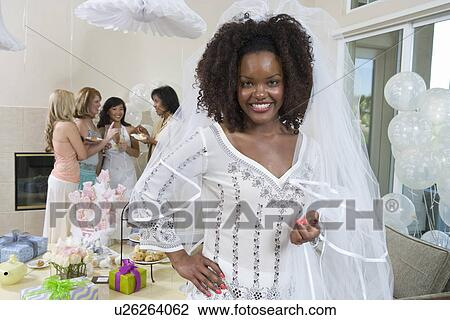 bride wearing veil at bridal shower