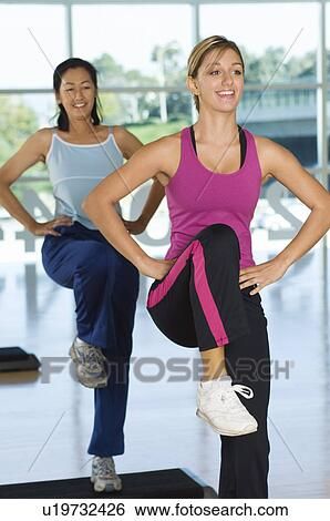 stock images of two women in step aerobics class u19732426 search