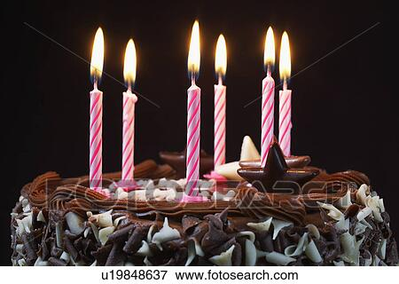 Picture Of Birthday Cake With Lit Candles Close Up U19848637