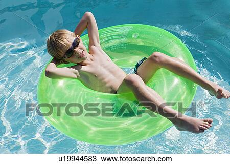 Boy on Float Tube in Swimming Pool Stock Image | u19944583 ...