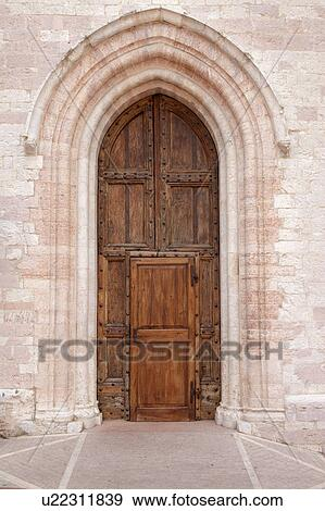 Stock Photograph of View of old double wooden arched door, with ...