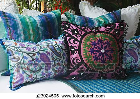 Pink And Blue Decorative Pillows On Bed Stock Photography