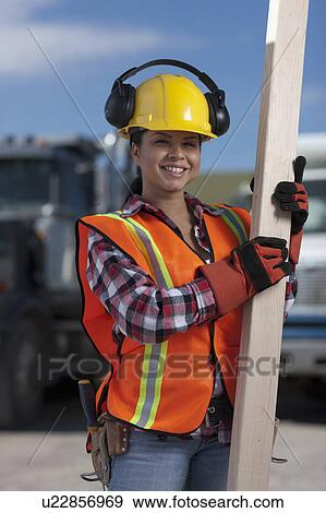 banque de photographies portrait de femme ouvrier construction sur chantier u22856969. Black Bedroom Furniture Sets. Home Design Ideas