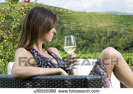 Cool Young Woman Sitting On Couch In Vineyard With White Wine Inzonedesignstudio Interior Chair Design Inzonedesignstudiocom