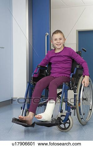 stock photography of girl in wheelchair foot in plaster u17906601