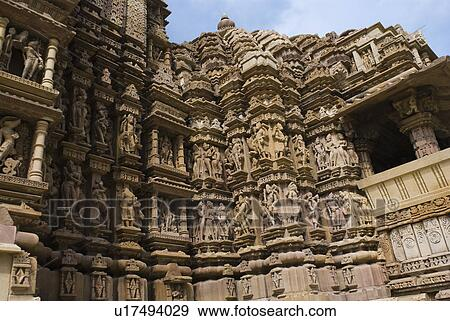 Sculptures on the wall of a temple, Lakshmana Temple, Khajuraho, Chhatarpur  District, Madhya Pradesh, India Stock Photo